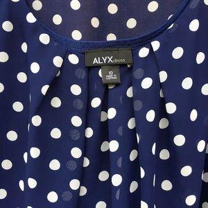 Knee length navy & cream polka dot dress & belt.